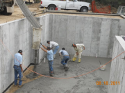 Off loading and spreading concrete for basement