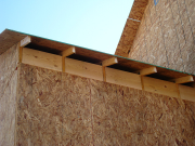 2x12 roll blocks will hold insulation in attic
