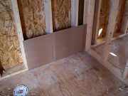 Insulation barrier prior to tub placement