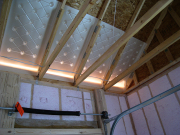 Attic baffles installed to control air movement from soffit