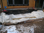 Blankets protecting ground before concrete pour