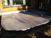 Rear concrete patio is placed with moisture and flashing control at wall