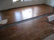 Engineered hardwood floor installation in great room in progress