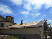 roof shingles being stripped
