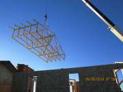 trusses being lifted by crane