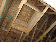 attic access is framed with an insulation retaining barrier