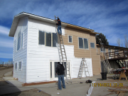 painters priming new siding