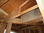 old trusses repaired with plywood gussets