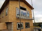 large & high windows are installed from scaffold