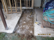 concrete patio is cut for new septic line
