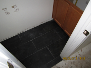 Floor tiles in lower bathroom