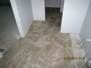 New tile floor in master bath & closet