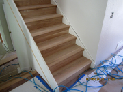 Stairs are finished in matching hardwood