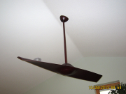 Sleek single blade fan in music room