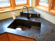 New modern sink and countertops in kitchen
