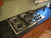 Gas cooktop and glass tile backsplash