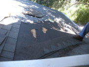 Removed shingles to check existing underlayment