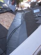 Installing underlayment ice & water shield at valley