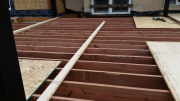 Deck joists are braced to stay straight