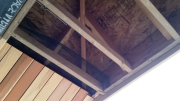 Insect screen behind roof soffits