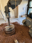 inch auger drilling 50 inches below existing slab