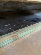 Ridged insulation in place on floor before fiberglass blown insulation