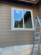 Window trimmed & caulked