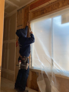 Insulator covering window before foam insulation