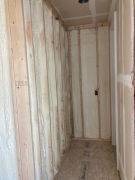 "3"" in existing window wall (R21) & 2"" in 2x6 wall (R14)"