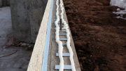 Foam under sill plates for excellent air infiltration control