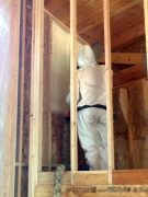 Closed cell foam insulation application in progress