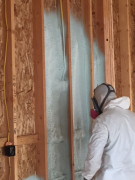 Applying closed cell foam insulation