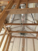 Ceiling insulation above insulated heat ducts