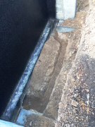 Foundation drain trenching